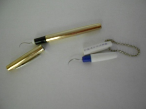Metal dental tools from the drug store- the white one is tiny & fits in your purse or pocket.