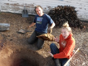 """My husband & daughter digging the hole for our traditional """"Terra Turkey"""" last Thanksgiving"""