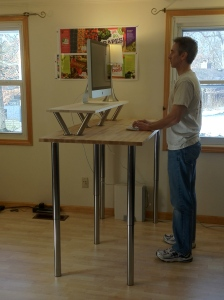 Jeff Sayre.com has a nice article about standing desks.